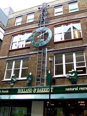 Holland & Barrett Clock, London (teresue) Tags: uk greatbritain england london clock unitedkingdom nealsyard automata hollandbarrett publicclock 2013 automataclock