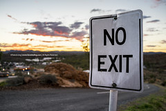Exit to Alice |  (francisling) Tags: sunset mountains zeiss 35mm t post dusk alice no sony trails rocky australia cybershot hills springs signage exit northern  anzac territory  sonnar    rx1   dscrx1  anzac