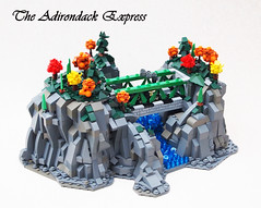 The Adirondack Express (Mark of Falworth) Tags: bridge autumn trees mountain river rocks lego scene moc rockwork