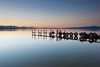 still waters (Andy Kennelly) Tags: sunset sea reflection mirror pier still dock tire calm tires hills salty waters flimsy mosquitos tranquil salton