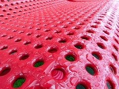 Wet Paint (maytag97) Tags: red color macro wet closeup bench hole seat holes parkbench upclose maytag97