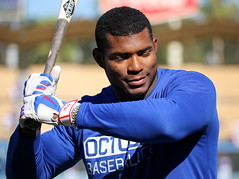 Dodgers outfielder Yasiel Puig warms up during batting practice before NLCS Game 4.
