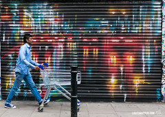 Trolley- Man (lightsnappers.com) Tags: trolley streetphotography walking colours bricklane london bethnalgreen graffiti art wallart leica