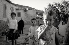 Who are you guys ? (Mehdi LABIDI) Tags: nikon d90 morocco maroc teza fes noir blanc portrait enfants child children visage groupe personnes people curiosity curiosit rencontre meet campagne countryside 1750mm noiretblanc blackandwhite famille family eye look regard bw