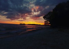 When a sunset looks nicer than you. (felixneale) Tags: evening cool sandywater water sand beach beautiful clouds sunsetting photography setting set sun pretty sunset