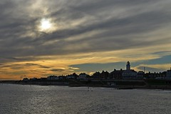 Southwold Landscape (DaveJC90) Tags: suffolk southwold pier souhtwoldpier building old classic wood metal lighthouse sea water northsea long exposure autumn winter sunrise sunset sun sunny sunlight light bright night sky blue cloud cloudy dark shadow beach bay hut huts reflection wave waves move movement colour colours crop croped nikon d5100 digital slr camera wide angle zoom lens 1020mm 1855mm detail sharp sharpness