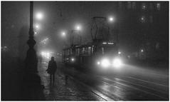 A foggy night in Prague (georgeupstairs) Tags: t3 tatra bridge lights czech autumn fog street silhouette figure prague vltava tram
