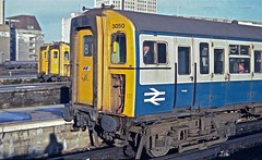 The Serried Ranks HR scan (Deepgreen2009) Tags: station yellow electric train slam doors platform fast railway line southern waterloo portsmouth cabs vep ranks serried
