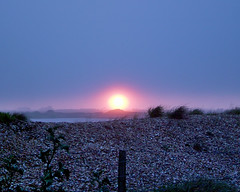 Sunset over Romney marsh. (Michael_Bkr) Tags: sunset lake pebbles marshes newromney