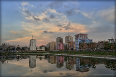 Cityscape Dhaka , Bangladesh (*illusionist*) Tags: sunset sky people cloud lake building tower water beautiful reflections interesting nikon colorful day ray cityscape afternoon view stunning dhaka lovely bangladesh panaroma d5100