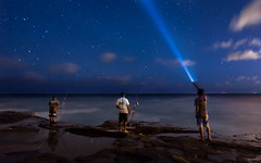 Signaling The Fish (tobyharriman) Tags: pictures ocean longexposure sea night canon stars photography hawaii coast fishing fisherman fishermen oahu scenic clear flashlight honolulu portlock sta