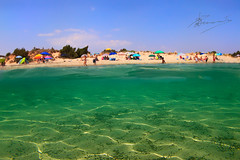 SUMMER (dtsortanidis) Tags: travel blue people green beach photography see sand sunny fisheye greece vacations pylos peloponnese dimitrios voidokoilia peloponnisos underover canon5dmarkii 815mm tsortanidis dtsortanidis