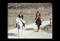 ss equest-107 (ndpa / s. lundeen, archivist) Tags: nick dewolf 1977 1970s color film aspen colorado rockymountains nickdewolf photographbynickdewolf slide slideshow foxhunt equestrian equestrians hunt woodycreek roaringforkvalley woodycreekhounds horse horses rider riders horseback woman man hat pipesmoker redjacket dirtroad roaringforkhounds