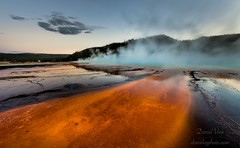 Beautiful cerulean geyser surrounded by colorful layers of bacteria, against cloudy blue sky... (Daniel Vie fotografia) Tags: park geyser grand spring faithful eruption erupting volcano old montana pool geo pressure usa national mud travel wyoming red methane yellow landmark active basin steam volcanic exploding dome yellowstone hydrocarbon forest boiling colorful blue prismatic sky scenic water geothermal nature force microorganisms heat ground vulcano geology bacteria pressurized landscape hot