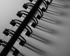 stitch. (mi ne volimo šalu) Tags: macromonday stitch abstract asymmetry artistic artificialstilllife closeup diagonal geometry hole lines arch macro minimalism monochrome negativespace notebook pattern paper shadow stillife texture blackandwhite