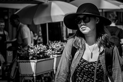 The girl with in the skin... (Periades) Tags: bw blackandwhite blackwhite bijou candid contrast chapeau fille fashion femme girl glasses hat jewel lunettes mode noiretblanc nb photoderue rue streetphotography street streethuman woman ombre shadow