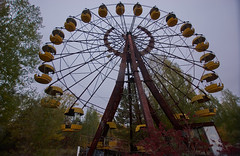 Pripyat Amusement Park (Chernobyl Exclusion Zone)_3 (Landie_Man) Tags: none pripyat chernobyl ionising radiation radioactive fair fairground amuse amusements amusement park may day parade soviet union ussr cccp disused abandoned forgotten left sad never opened ran communism communist fun ferris wheel bumper cars dodgems swing ride swings nature reclaim redstar red star cliche clche