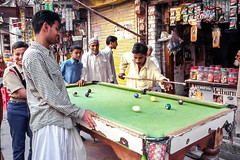 People playing billiards, Walled City of Lahore, Pakistan (travelingmipo) Tags: travel photo film pakistan     pakistani lahore   people walledcityoflahore oldcity   street alley bazaar billiard