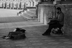 The talented musician (xiaolifra) Tags: shadow siviglia walking espana spain lights chance portraits picoftheday photo moment time bridge amazing colorful dark blackwhite black simply emotions