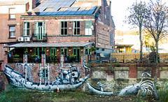 A Sheffield Kracken Hunt (PDKImages) Tags: emaiated television streetart sheffieldstreetart backstreet city abandoned urban art girl relaxing windows broken kissing wall urbanart cracken mural guarding