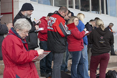 Filling in the Programmes (Richard Amor Allan) Tags: bike mud bikes cycle stokeontrent fans rider supporters speedway cycles riders motorcyles programmes scunthorpesaints stokepotters loomerroad