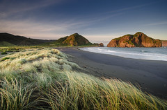 Whatipu (Nick Twyford) Tags: blue sunset sea newzealand sky cliff sunlight seascape colour beach clouds island evening coast nikon surf waves expression wideangle auckland filter lee northisland westcoast legacy nationalgeographic excellence whatipu warmcolors 1024mm 06gnd d7000 legacyexcellence lee06gnd 12gnd lee12gnd