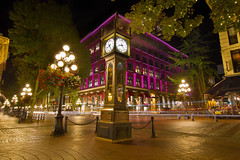 Historic Steam Clock in Gastown Vancouver BC (JPLPhotographyPDX) Tags: old travel flowers light cars clock tourism lamp architecture night vancouver buildings shopping evening long exposure bc stones district trails restaurants columbia historic steam baskets hanging british posts gastown cobblered