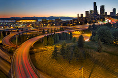 Seattle Downtown Highway Traffic Light Trails (JPLPhotographyPDX) Tags: road seattle city travel blue trees light sunset sky building skyline modern landscape evening washington twilight highway downtown cityscape skyscrapers traffic dusk stadium trails historic hour freeway sound olympic peninsula puget