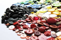 Buttons (Pikaluk) Tags: blue red brown white black green yellow purple buttons clear button piles hundredsofbuttons