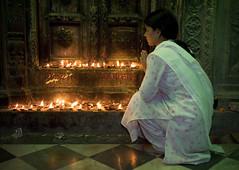 Young woman kneeling in a temple with candles, Varanasi Benares (Pxel) Tags: portrait people festival portraits asian religious temple bath asia delhi indian prayer religion praying atmosphere holy railwaystation bombay varanasi canon5d priest henna mumbai hindu hinduism holi kolkata calcutta jaisalmer jhodpur thar newdelhi ganga ganges benares chandnichowk thirdworld jamamasjid travelphoto fotodeviaje jorgeroyan candleprayprayingorationyoungwomanhinduritualritualstra