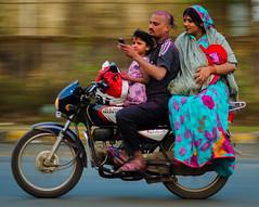 """Safety? What safety?"" (rai.vikramaditya) Tags: street family baby india motion blur horizontal speed nikon indian motionblur editorial panning tamron70300 nikond5100"