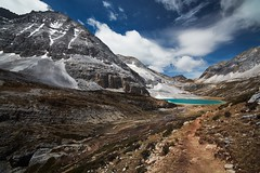 The Heart of the Mountain (Eddie HBH) Tags: china blue lake snow mountains nature hope rocks turquoise peaceful hike hidden sichuan yading distagon2815 distagont2815