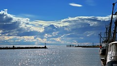 Calm after the rain  ( EXPLORED - Thank-you ) (Images by Christie  Happy Clicks for) Tags: steveston calm fishingboats nautical nauticalbeacon stevestonheritagefishingvillage fishermanswharf fraserriver pov seascape river breakwater nikon d5200 bc canada clouds sky water reflections