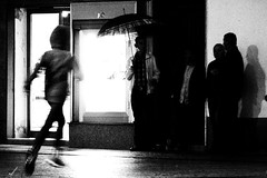 Run ... it's raining! (Lucio Busa) Tags: streetphotography street rainy rain run child children shadows black white olympus omd em5 grainy italy schiavonea corigliano calabria autumn night