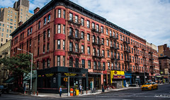 2016 - New York City - Red brick (Ted's photos - Returns late November) Tags: 2016 cropped nikon nikond750 nikonfx nyc newyorkcity tedmcgrath tedsphotos vignetting redbrick redbrickbuilding streetscene street railings steps stairs fireescape restaurant ranchotequileria bronze people peopleandpaths nyccab cab taxi vehicles bicycles backpack bollards firehydrant