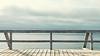 stormlight by the sea (-liyen-) Tags: troutriver grosmorne newfoundland boardwalk fence sea atlanticocean eastcoast tranquility light lateintheday evening calm beauty sky cloud blue fujixt1 minimalismminimal simplicity symmetry challengeyouwinner cyunanimous