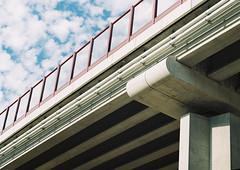 ...under the bridge (Robert Ugroci) Tags: bridge bron broen sky clouds blue glass praktica ltl3 helios 442 582 fujicolor c200 35mm filmlovers c41
