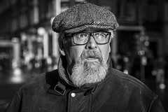 The Sun Is Shining (Leanne Boulton) Tags: monochrome depthoffield bokeh people portrait urban street candid portraiture streetphotography candidstreetphotography candidportrait streetportrait streetlife man male face facial expression look emotion feeling mood closeup beard cap bright sunlight wonder tone texture detail natural outdoor light shade shadow naturallight city scene human life living humanity society culture canon 5d canoneos5dmarkiii 70mm ef2470mmf28liiusm character black white blackwhite bw mono blackandwhite glasgow scotland uk