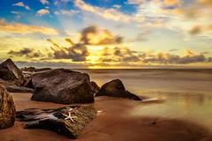Vilano  Beach Sunrise with 10 second exposure (jkellogg01) Tags: neutral density filter 9 stop long exposure vilano beach sunrise sunset star fish starfish rocks water canon eos 7d mark ii ef1740mm f4l usm atlantic ocean blue yellow sun rays