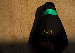 Portrait of an iranian shiite muslim woman with her face hidden by a veil mourning imam hussein on tasua during the chehel manbar ceremony one day before ashura, Lorestan province, Khorramabad, Iran (Eric Lafforgue) Tags: 1people 30s adult adultsonly ashura celebration ceremony chador clothing colorimage copyspace covered hidden horizontal hussain imamhussein iran islam khorramabad lookingatcamera memorialevent middleeast mourner mourning muharram muslim mysterious niqab oneperson onewomanonly outdoors people persia portrait religion religious ritual script shia shiism shiite tasua unrecognizableperson veil veiled waistup woman lorestanprovince ir