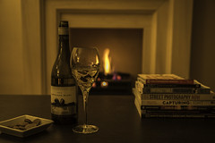 324/366: Well earned... (judi may) Tags: 366the2016edition 3662016 day324366 19nov16 wineglass wine glass bottle winebottle table books fire flames fireplace dish canon7d