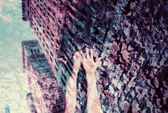 Harmony of Garden and City (thomas_anthony__) Tags: lomochrome lomo lomochromepurple lomography purple doubleexposure multipleexposure inscanner scanner buildings building facade hands city garden leaf plants film analog 35mm
