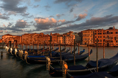 Gondolas on the Grand Canal at sunrise, Venice, Italy