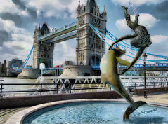 Girl with a Dolphin - Tower Bridge (Steve Taylor (Photography)) Tags: uk bridge blue england sculpture cloud playing london tower water fountain girl silhouette thames lady towerbridge river naked happy hotel droplets jumping upsidedown cloudy britain path dolphin thistle towers joy down gb sculptor exuberance splashing frolicking stkatharinedocks davidwynne hoteltower girlwithadolphin thamespatheast stcatharinedocks eastthistle bridgetowertower