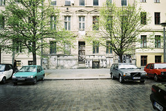 (jcarroza) Tags: street trees building berlin cars film 35mm germany graffiti spring mitte prenzlauerberg 2012