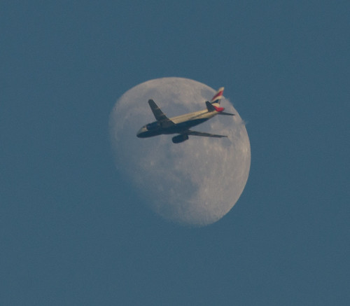 Jet flying in front of the evening Moon 21 May 2013