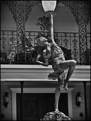 Heights Dancing Figure Lamp n Ironwork BnW (oldusephemera) Tags: city blue original light shadow red portrait people favorite woman dog pet house man flower detail cute art nature face leaves weather animal yellow closeup contrast cat fence pose garden dark bench photo funny colorful child purple artistic candid best deli emotional darling bnw viral