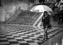 I'm the Rain (petertandlund) Tags: street city people urban blackandwhite bw blancoynegro girl monochrome rain umbrella pattern sweden stockholm sdermalm streetphotography streetscene sthlm blackdiamond medborgarplatsen peopleinmotion xe1 fujix