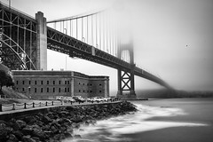 Golden Gate in Fog (melfoody) Tags: sanfrancisco longexposure bridge bw fog blackwhite waves goldengatebridge fortpoint nd110