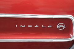 Impala Car Logo (shaire productions) Tags: street red urban car wheel sign closeup vintage logo photography photo shiny image picture pic retro photograph signage vehicle impala rim rims lowrider imagery imagered